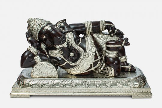 Wood with Metal reclining Ganesha